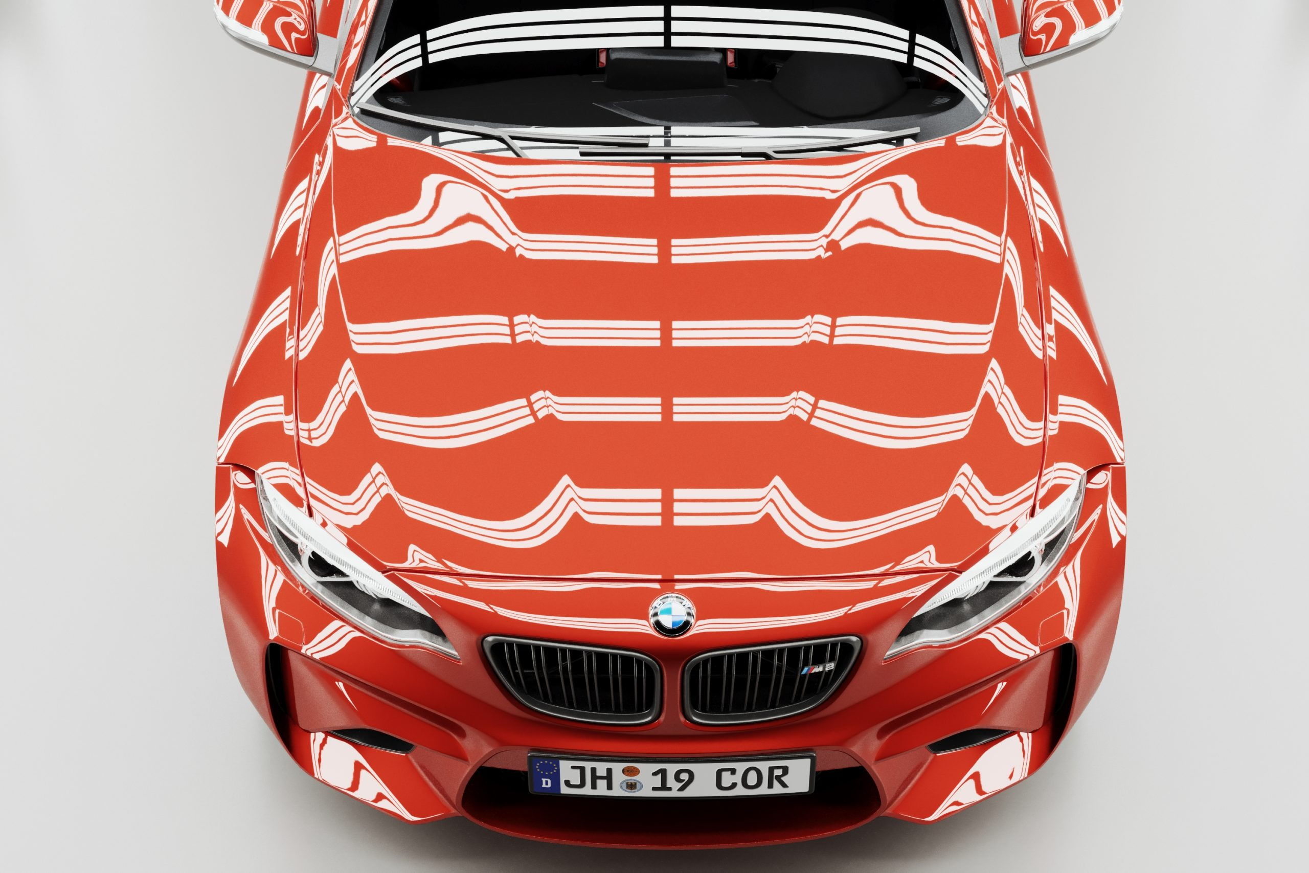 Red BMW M2 hood render in light tunnel with reflections